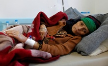 A woman with suspected cholera infection lies on a bed at a cholera treatment centre in Sanaa, Yemen, May 15, 2017. Reuters