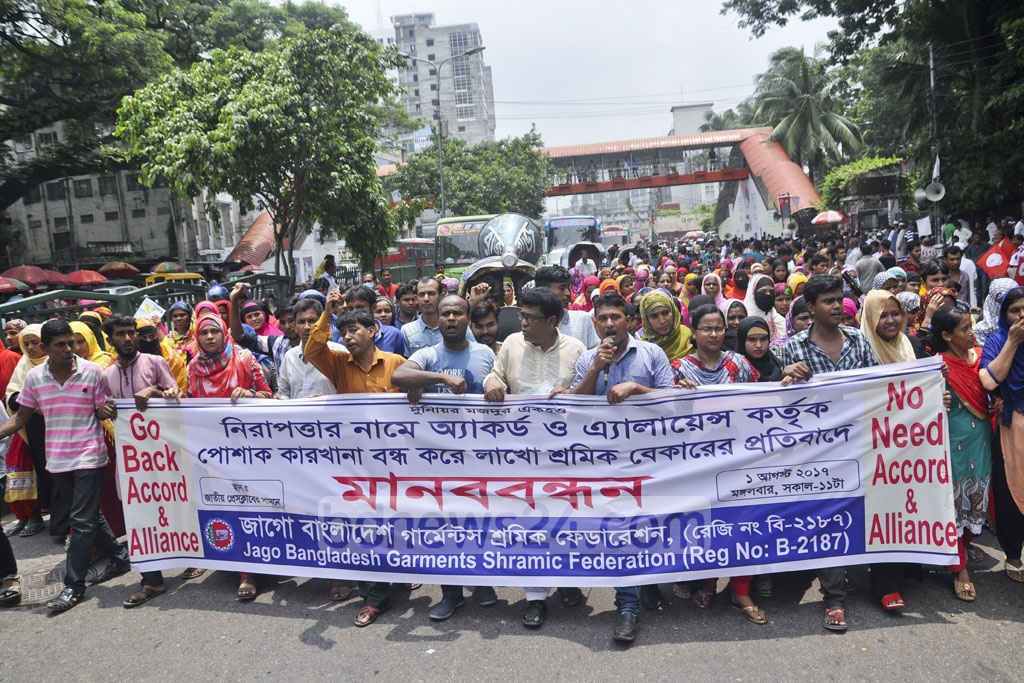 Apparel workers' platform Bangladesh Garments Shramic Federation demonstrated in Dhaka on Tuesday protesting what they describe as shutdown of factories by Accord and Alliance, the safety inspection groups of European and North American retailers.