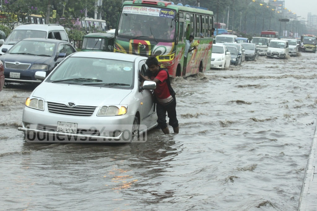 A car broke down on the submerged Airport Road on Wednesday afternoon. Photo: abdul mannan