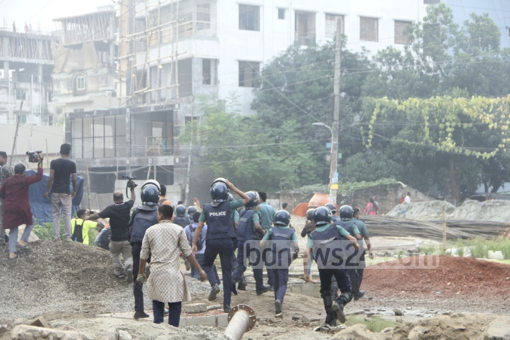 Police fight a running battle with angry locals demonstrating against the alleged murder of a house help at Banasree in Dhaka on Friday afternoon.