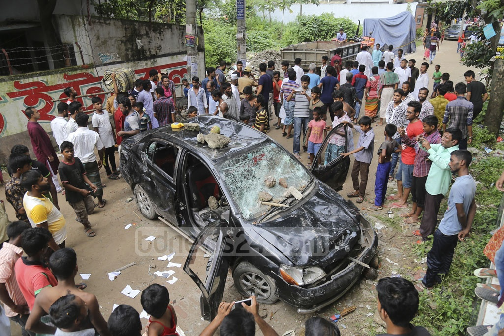Locals, alleging murder of a house help, attacked a house in capital's Banasree on Friday. They torched a car parked in front of the house and fought a running battle with the police when the law enforcers intervened.
