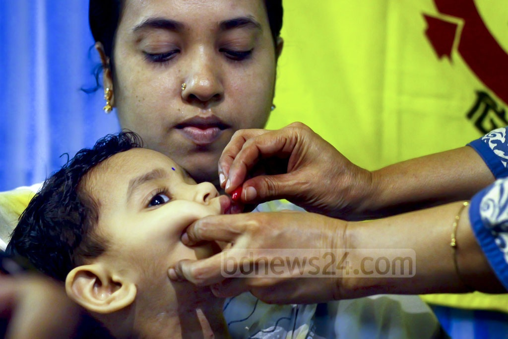 A child is given vitamin 'A+' capsule gelatin at the Maternal and Child Health Training Institute in the capital's Azimpur as part of a countrywide campaign.