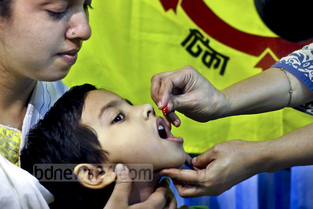A child is given a vitamin 'A+' capsule gelatin at the Maternal and Child Health Training Institute in the capital's Azimpur as part of a countrywide campaign.