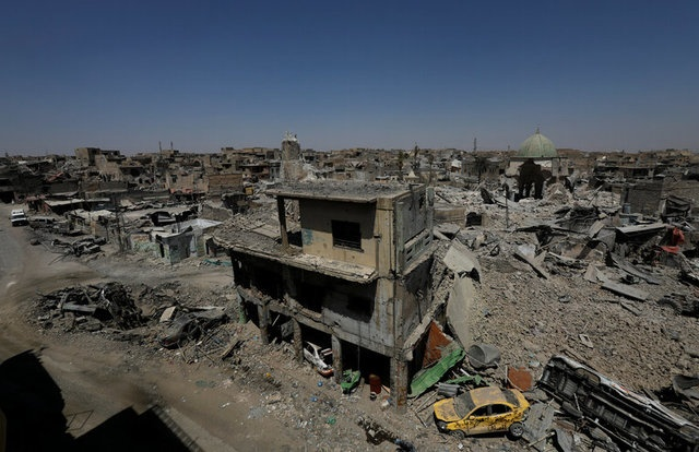 The ruins of the Grand al-Nuri Mosque and al-Hadba minaret are seen in the destroyed Old City of Mosul, Iraq August 5, 2017. REUTERS/Suhaib Salem