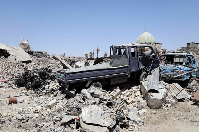 Destroyed vehicles are seen near the destroyed Grand al-Nuri Mosque and al-Hadba minaret in the Old City of Mosul, Iraq August 5, 2017. REUTERS/Marius Bosch