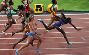 Athletics - World Athletics Championships - Women's 100 Metres Final - London Stadium, London, Britain – Aug 6, 2017. Tori Bowie of the US falls after winning the final. Reuters