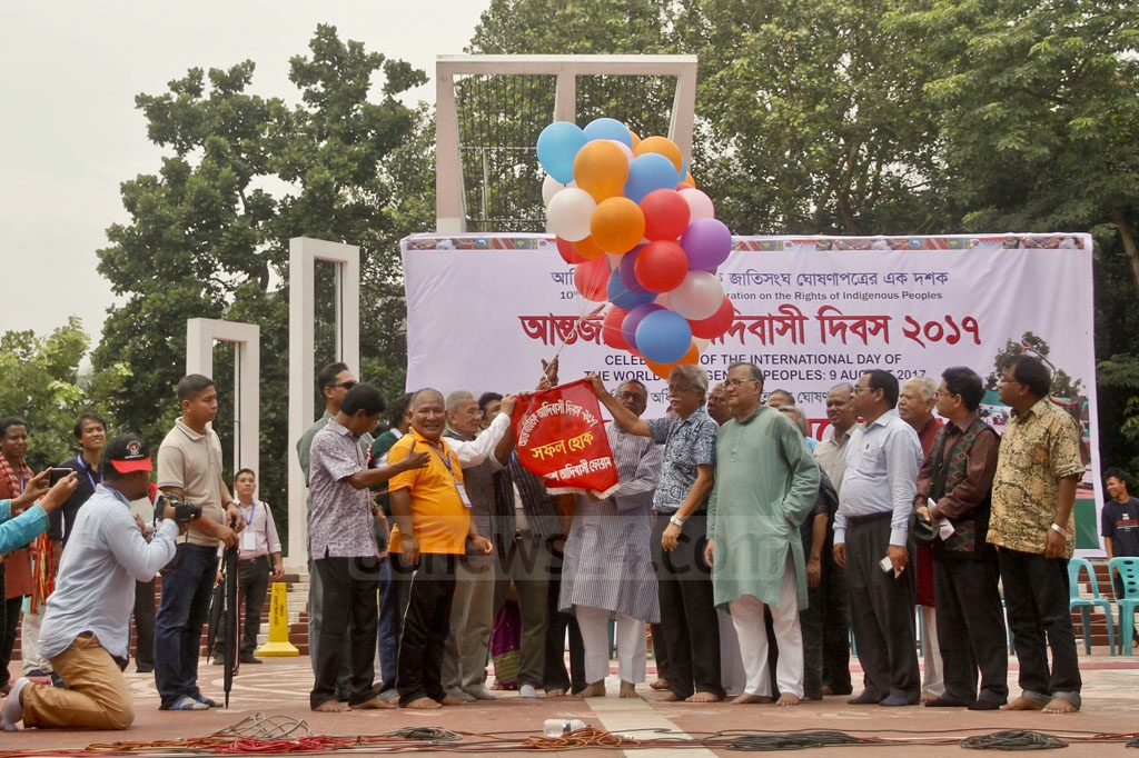 Balloons are released in the air to inaugurate a programme to mark the International Day of the World's Indigenous Peoples at Dhaka's Central Shaheed Minar on Wednesday. Photo: tanvir ahammed