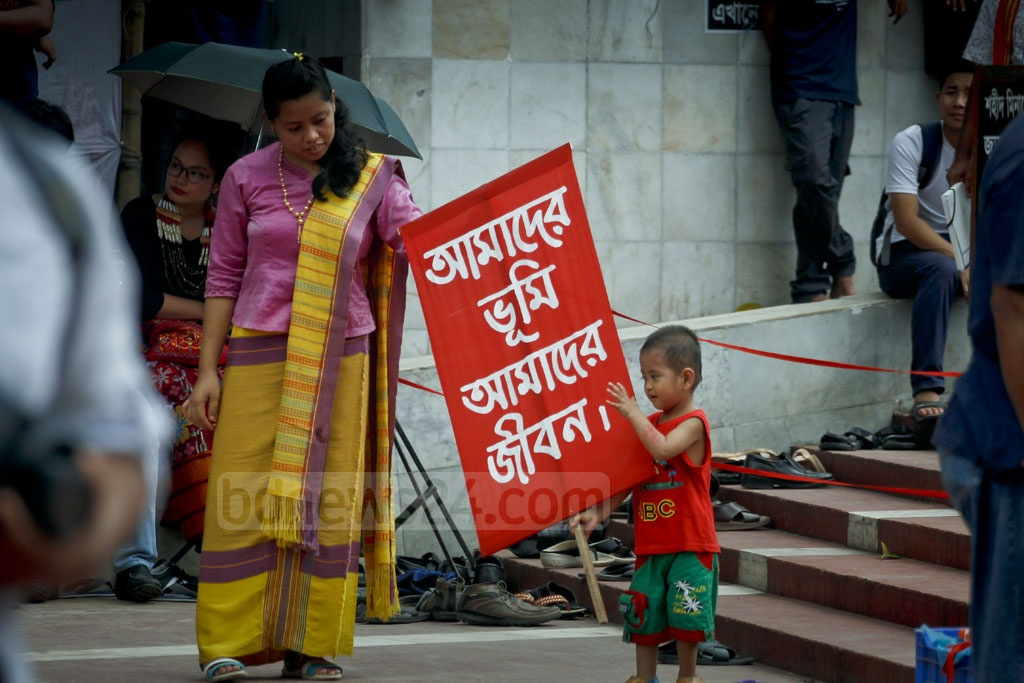 A child from a minority ethnic group in Bangladesh joins a programme to demand indigenous status on International Day of the World's Indigenous Peoples on Wednesday. Photo: tanvir ahammed