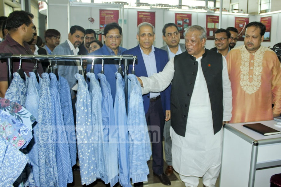 Minister for Industries Amir Hossain Amu along with the organisers visiting a stall at Textech Bangladesh, an international exhibition of textile and garment machines, cotton and chemical agents used in textile industry, at the International Convention City Bashundhara in Dhaka.