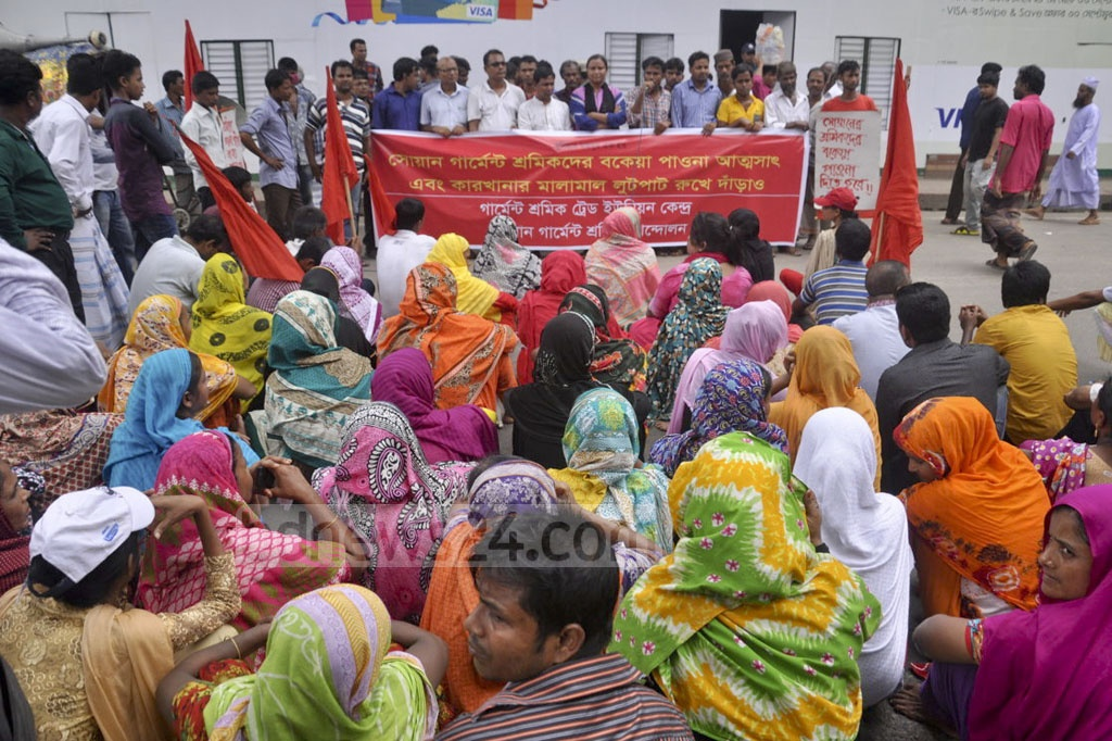 Workers of Swan Garments Pvt Ltd demonstrate in front of the National Press Club in Dhaka on Thursday demanding immediate payment of their outstanding salaries.