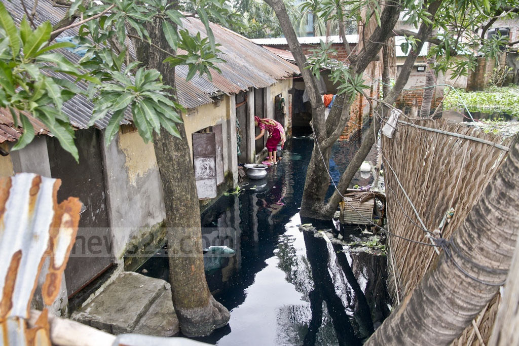 The front yard of this tin-roofed house in Dogair, Demra in the capital has rremained waterlogged for three months now.