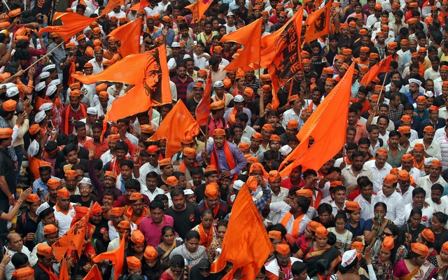 People wave flags as they take part in a protest, organised by Maharashtra state's Maratha community, to press their demands for reserved quotas in government jobs and college places for students in Mumbai, India, Aug 9, 2017. Reuters