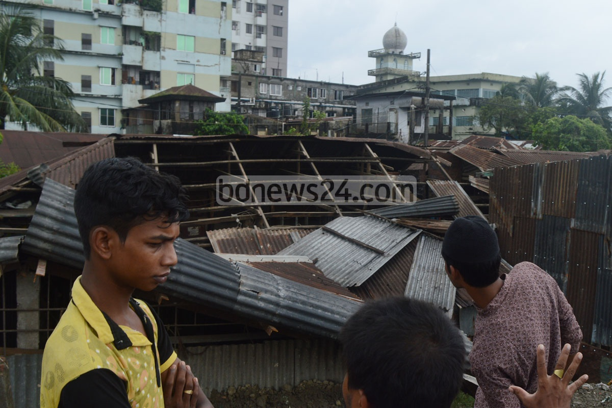 A passerby died and two more were injured after being hit by the tin roof of this saw mill, which was blown off by strong winds at Chittagong's Fishery Ghat on Friday. Photo: suman babu