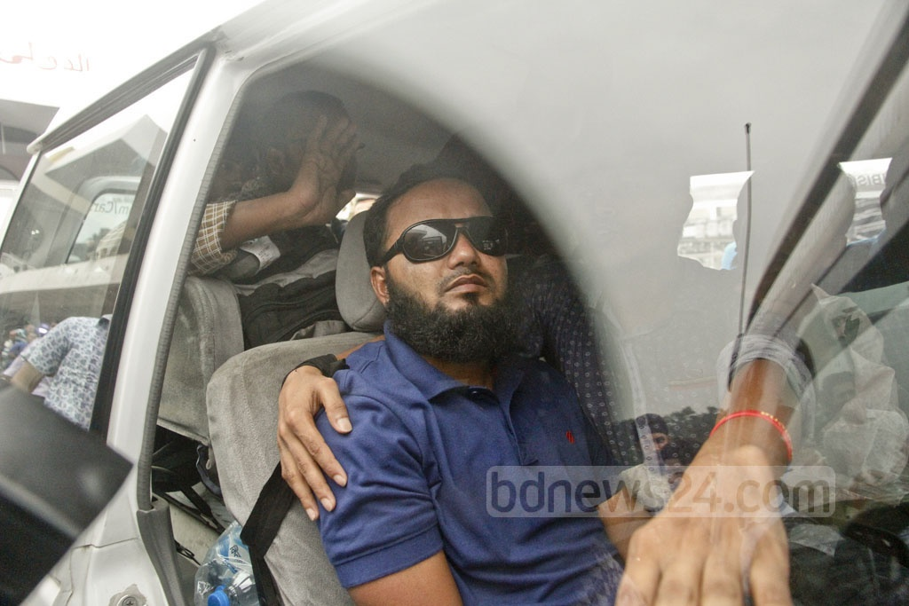 Siddiqur Rahman, a Titumir College student, who was hit in the face by police teargas shell and lost eyesight, came back after treatment in Chennai, India, but without the vision. The photo is taken on Friday from Shahajalal International Airport in Dhaka. Photo: tanvir ahammed