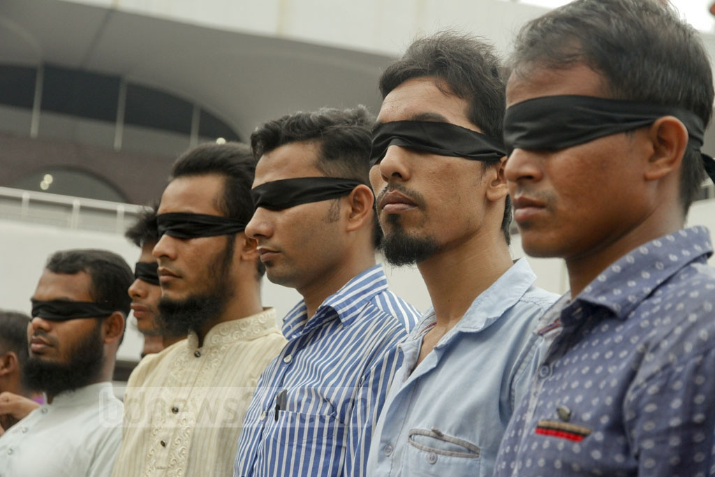 Friends of Siddiqur Rahman, a Titumir College student, who was hit in the face by police teargas shell and lost eyesight, get blindfolded as a sign of protest and in solidarity with their friend after he came back from Chennai, India. The photo is taken on Friday from Shahajalal International Airport in Dhaka. Photo: tanvir ahammed
