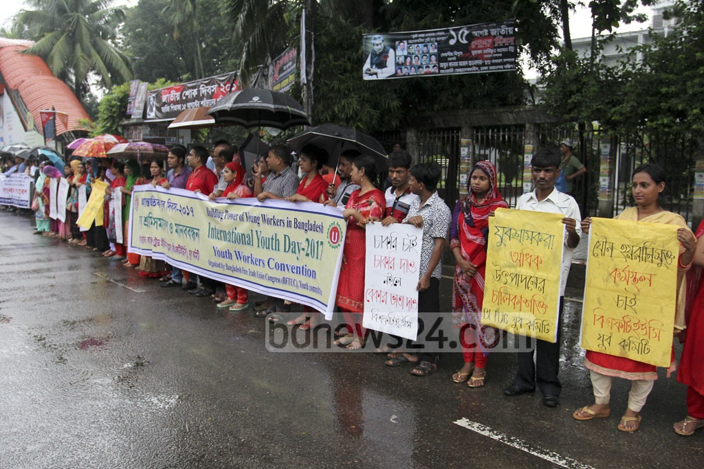 Bangladesh Free Trade Union Congress organises a human chain outside the National Press Club on Friday, a day ahead of International Youth Day.