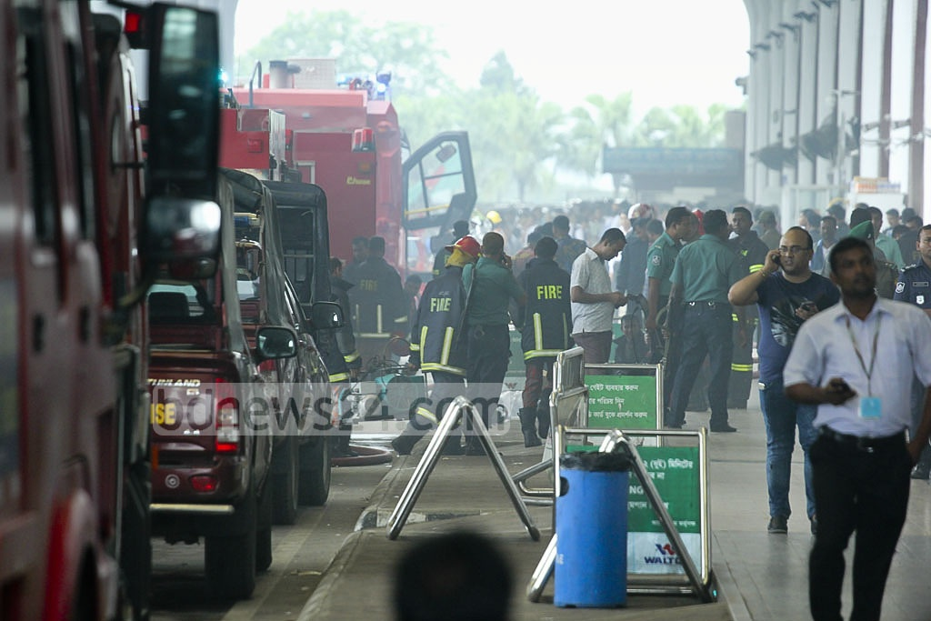 Firefighters and their trucks are seen on the driveway of Dhaka's Hazrat Shahjalal International Airport on Friday. Photo: abdul mannan