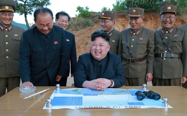 FILE PHOTO - North Korean leader Kim Jong Un reacts during the long-range strategic ballistic rocket Hwasong-12 (Mars-12) test launch in this undated photo released by North Korea's Korean Central News Agency (KCNA) on May 15, 2017. KCNA via Reuters