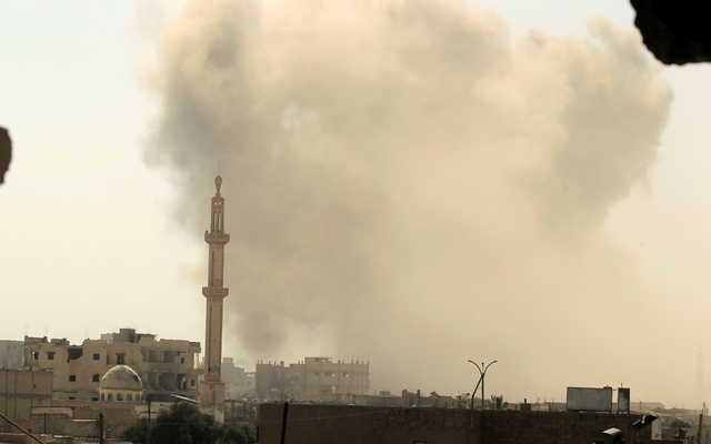 A smokes rises after an air strike during the fighting between the Syrian Democratic Forces and Islamic State in Raqqa, Syria, on Aug 10. Reuters