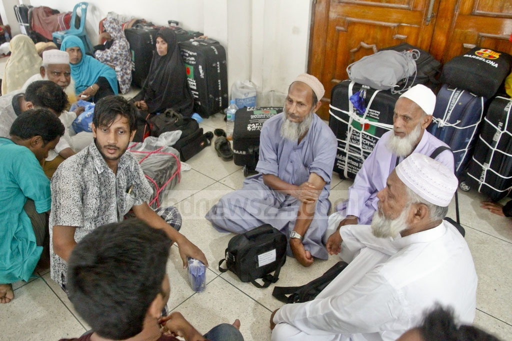 Pilgrims wait for their flights at Ashkona Hajj camp near the airport in Dhaka. The photo is taken on Saturday.