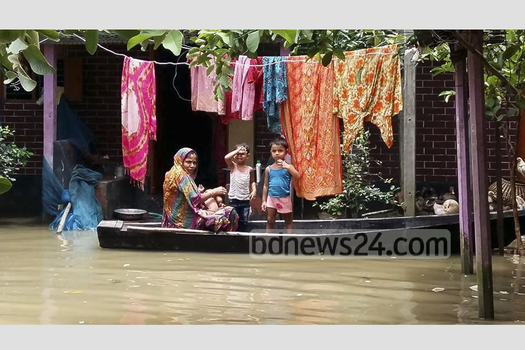Residents in some areas of Comilla city and its suburb have been suffering from waterlogging that forcing them to use boats for their daily chores. The picture is taken on Saturday.