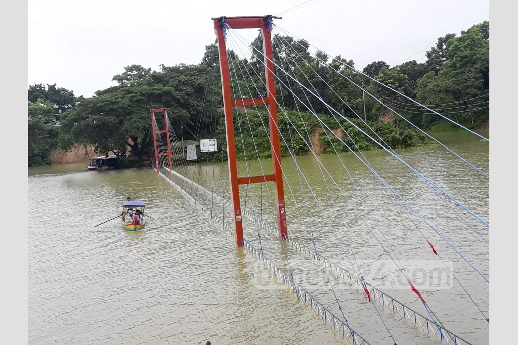 The hanging bridge in Kaptai Lake has gone under water with the alarming rise of water level. The photo is taken on Saturday.
