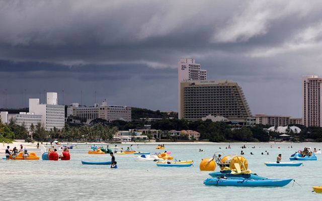 Tourists frolic on the waters overlooking posh hotels in Tumon tourist district on the island of Guam, a US Pacific Territory, August 10, 2017. Reuters