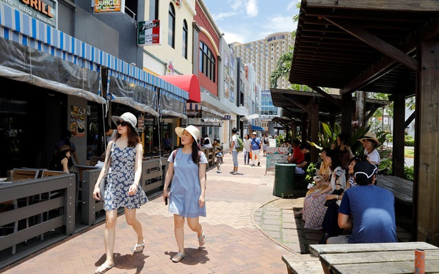 Tourists stroll in the Tumon tourist district on the island of Guam, a US Pacific Territory, August 10, 2017. Reuters