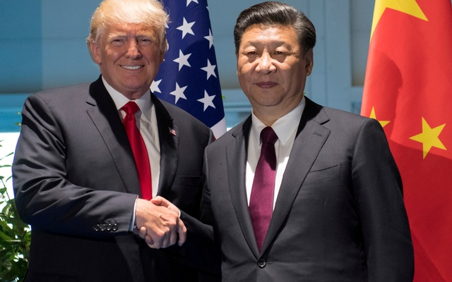 US President Donald Trump and Chinese President Xi Jinping shake hands prior to a meeting on the sidelines of the G20 Summit in Hamburg, Germany, July 8, 2017. Reuters