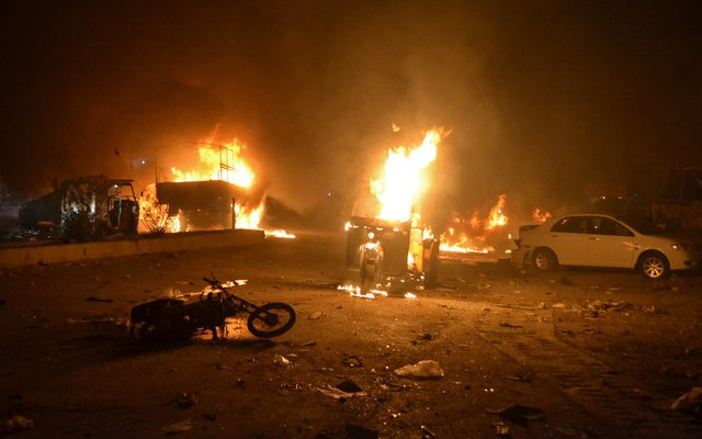 Vehicles are seen burning after a bomb blast in Quetta, Pakistan August 12, 2017. Reuters