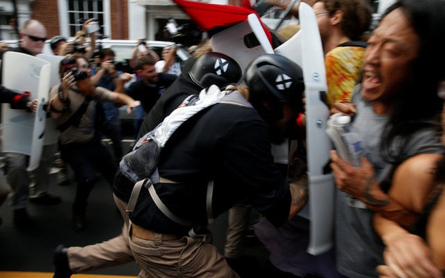 Members of white nationalists clash a group of counter-protesters in Charlottesville, Virginia, US, August 12, 2017. Reuters