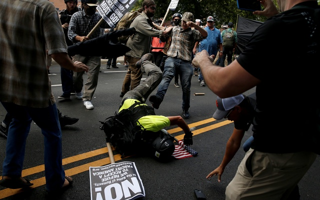 Counter demonstrators attack a white supremacist during a rally in Charlottesville, Virginia, US, Aug 12, 2017. Reuters