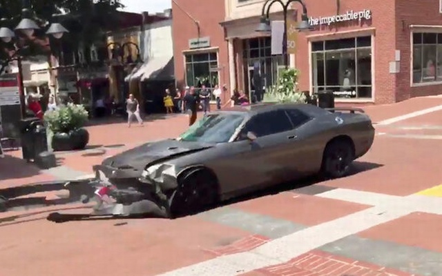 A vehicle is seen reversing after ploughing into the crowd gathered on a street in Charlottesville, Virginia, US, after police broke up a clash between white nationalists and counter-protesters, August 12, 2017, in this still image from a video obtained from social media. Courtesy of Brennan Gilmore/via Reuters