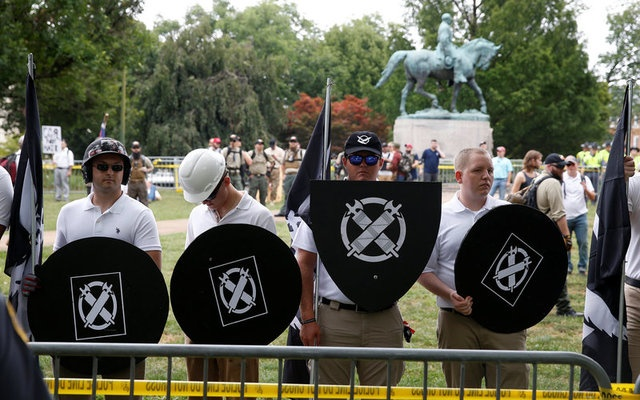 White supremacists gather under a statue of Robert E. Lee during a rally in Charlottesville, Virginia, US, August 12, 2017. Reuters