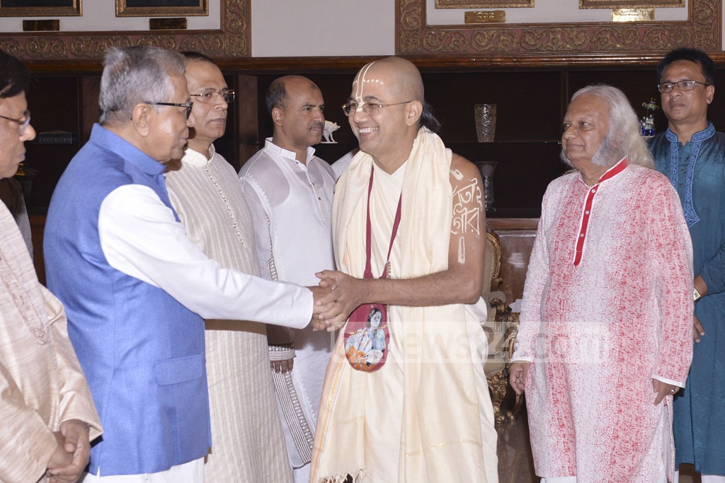 President Md Abdul Hamid greets representatives from the Hindu community at a Janmashtami reception at the Bangabhaban on Monday.