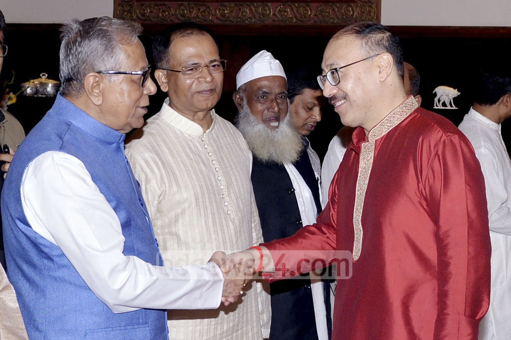 President Md Abdul Hamid greets Indian High Commissioner Harsh Vardhan Shringla at a Janmashtami reception at the Bangabhaban on Monday.