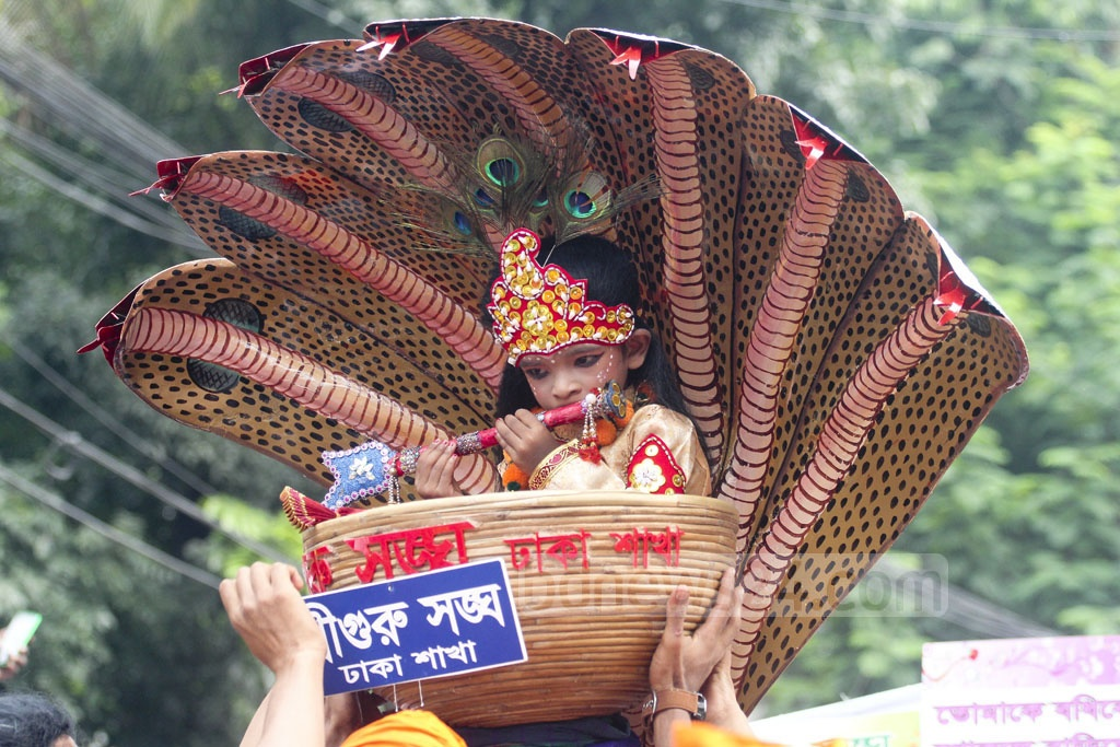 A child dressed up as Krishna at a parade in Dhaka's Palashi in celebration of the Janmashtami. Photo: asif mahmud ove