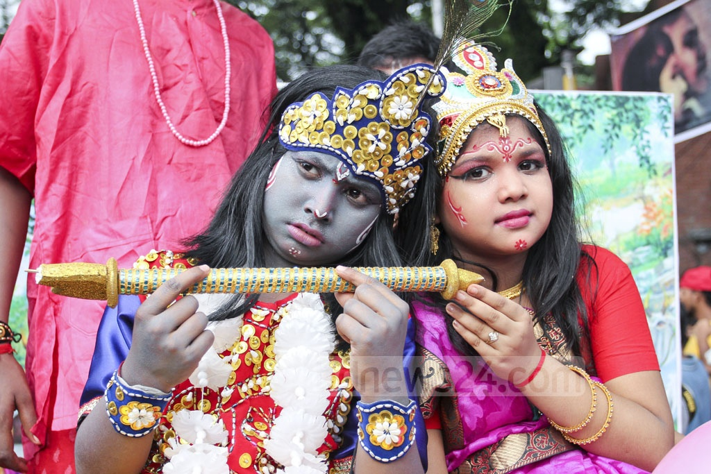 A couple dressed up as Krishna and his principal consort Radha at a parade taken out in Dhaka on Monday. Photo: asif mahmud ove