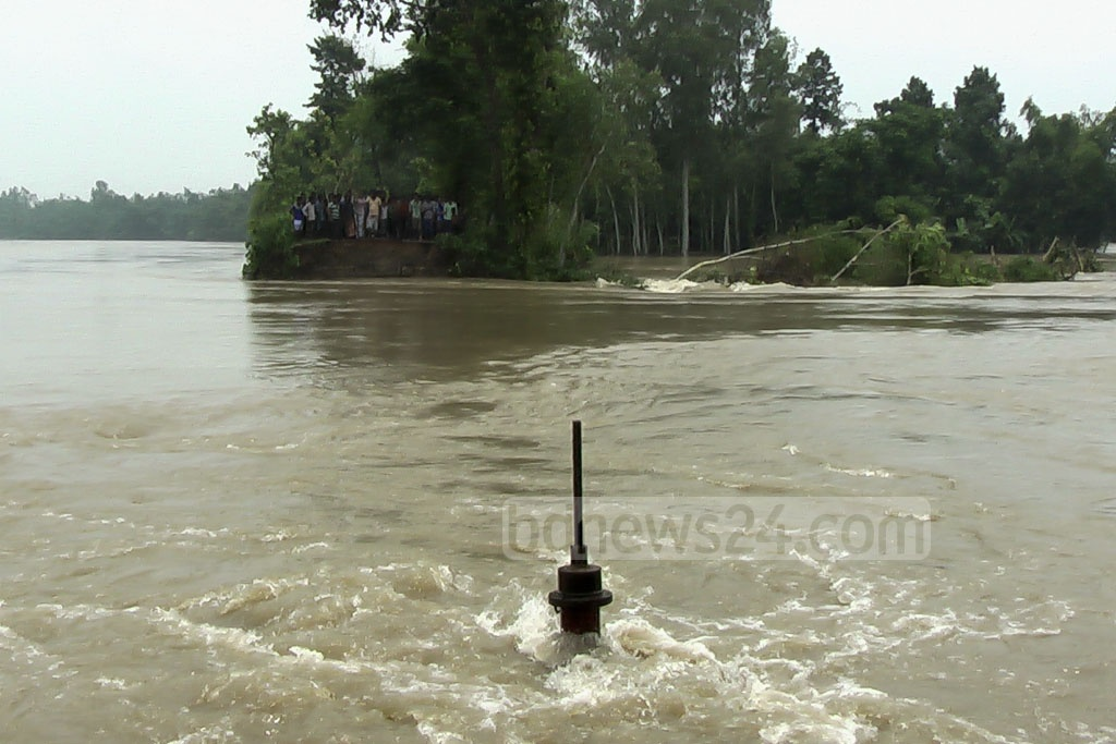 A large part of the dam protecting Syedpur town in Nilphamari has collapsed, submerging many areas.