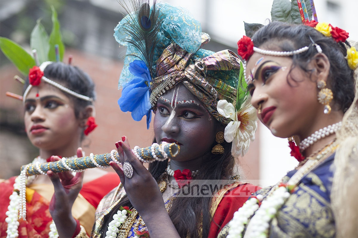 A couple dressed up as Krishna and his principal consort Radha at a parade taken out in Dhaka on Monday. Photo: nayan kumar