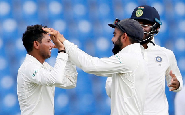 Cricket - Sri Lanka v India - Third Test Match - Pallekele, Sri Lanka - August 13, 2017 - India's Kuldeep Yadav celebrates with captain Virat Kohli after taking the wicket of Sri Lanka's Dilruwan Perera.