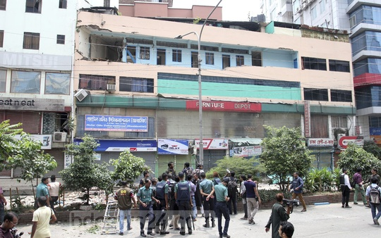 Police personnel and journalists at the scene near Hotel Olio International at Panthapath where a suspected militant blew himself up during a counter-terror raid on Tuesday. Police say he was planning to attack National Mourning Day events at the Bangabandhu Memorial Museum. Photo: asif mahmud ove