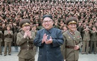 North Korean leader Kim Jong Un claps with military officers at the Command of the Strategic Force of the Korean People's Army (KPA) in an unknown location in North Korea in this undated photo released by North Korea's Korean Central News Agency (KCNA) on August 15, 2017. Reuters