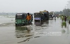 Streets in Sherpur have gone under water with the swelling of the Brahmaputra River. The photo of vehicles and people wading through a submerged road was taken on Wednesday.