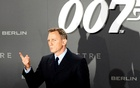 Actor Daniel Craig poses for photographers on the red carpet at the German premiere of the new James Bond 007 film