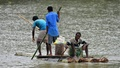 Villagers row on a makeshift raft as they try to move to safer places at a flooded village in Nagaon district, in the northeastern state of Assam, India August 16, 2017. REUTERS/Anuwar Hazarika