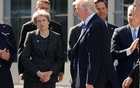FILE PHOTO: US President Donald Trump (R) walks past Britain's Prime Minister Theresa May at the start of the NATO summit at their new headquarters in Brussels, Belgium, on May 25, 2017. Reuters