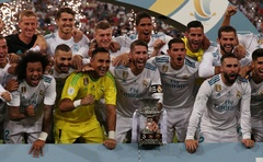 Soccer Football - Real Madrid vs Barcelona - Spanish Super Cup Second Leg - Madrid, Spain - Aug 17, 2017 Real Madrid's Sergio Ramos celebrates with trophy and team mates after winning the Spanish Super Cup. Reuters