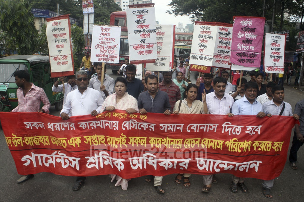 Garments Workers Rights Movement demonstrate in front of the National Press Club in Dhaka on Friday demanding payment of festival bonus before the Eid-ul-Azha. Photo: asif mahmud ove
