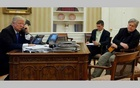 FILE PHOTO: US President Donald Trump (L), seated at his desk with National Security Advisor Michael Flynn (2nd R) and senior advisor Steve Bannon (R), speaks by phone with Australia's Prime Minister Malcolm Turnbull in the Oval Office at the White House in Washington, US January 28, 2017. Reuters